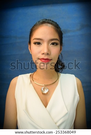 Thai woman with blue screen - stock photo