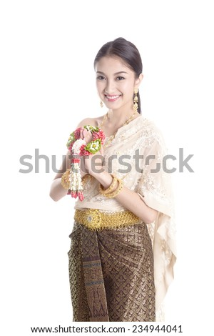 Thai women welcome with traditional Thai suit in Studio - stock photo