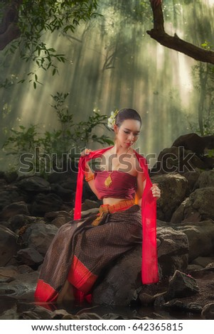 Thai women with red dress in northeastern Burirum, Thailand