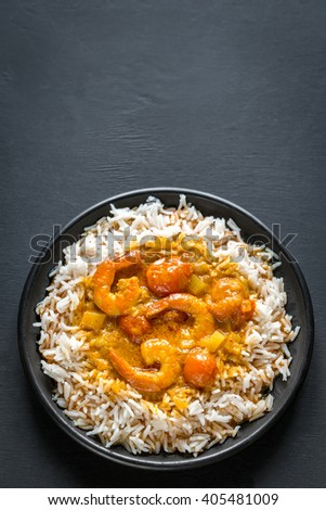 Thai yellow curry with seafood and white rice - stock photo