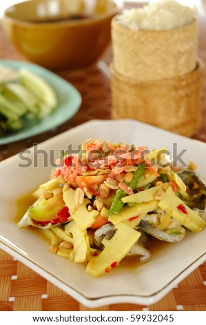 thai yellow papaya salad with bam boo root