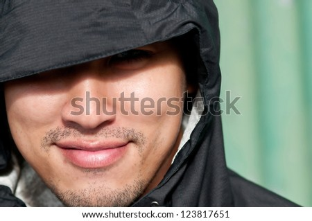 Thai Young man in hood - stock photo