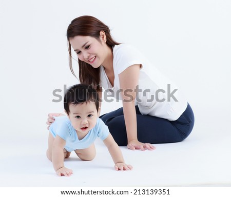 Thai young mom and son smiling isolated  - stock photo