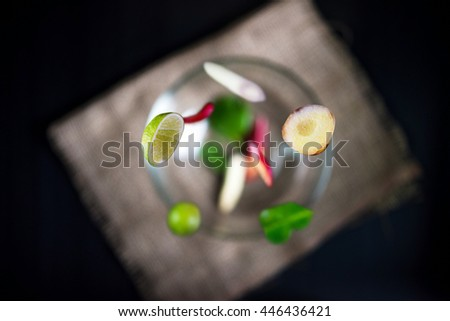 """thaifood """"Tom Yam Kung"""" food falling, flying traditional cuisine in Thailand on sack background.(selective focus) - stock photo"""