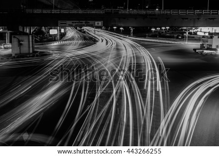 Thailand and Japan Bridge. Abstract city blur night light ,Traffic and Bridge at Bangkok city center. Business concept of success industry tech architecture.Black and White concept. - stock photo