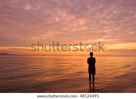 Thailand. Andaman sea. Phi Phi island. Magic sunrise landscape and a silhouette of alone girl