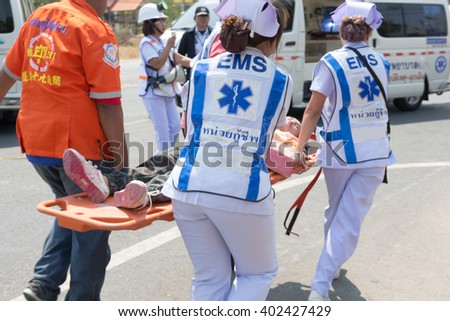 THAILAND APR-07 : Emergency responce team and rescue team  save life the patient from car accident on April 07,2016 at Highway in  Thailand - stock photo