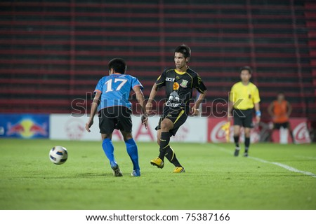 THAILAND- APRIL 16 : D.Dinkit(Black) in action during Thai Premier League (TPL) between TOT Sc (Blue) vs Army Utd. (Black) on April 16, 2011 at  Thunderdome Stadium Bangkok, Thailand