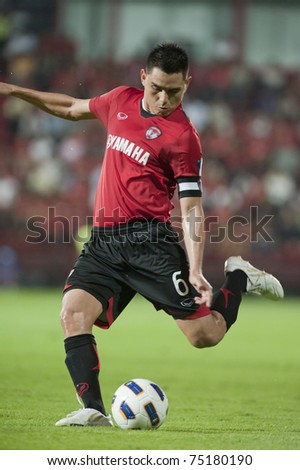 THAILAND- APRIL 12:Phanrit Nataporn in action during AFC CUP between Muang Thong utd (Red) vs Victory sc  (white) on April 12, 2011 at Thunderdoma Stadium Nonthaburi, Thailand - stock photo