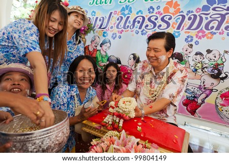 THAILAND - APRIL 11: Thai people celebrate Songkran (new year / water festival: 13 April) by giving garlands to their seniors and asked for blessings on April 11, 2012 in Nakhonratchasima, Thailand. - stock photo