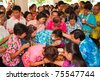 THAILAND - APRIL 13: Thai people celebrate Songkran (new year / water festival) by giving garlands to their seniors and asked for blessings on April 13, 2011 in Nakhonratchasima, Thailand. - stock photo
