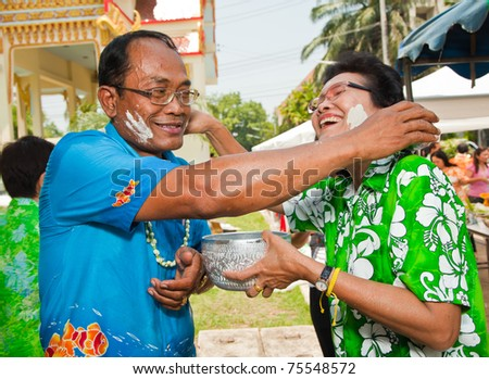 THAILAND - APRIL 13: Thai people celebrate Songkran (new year / water festival) by giving water to each other on April 13, 2011 in Nakhonratchasima, Thailand. - stock photo