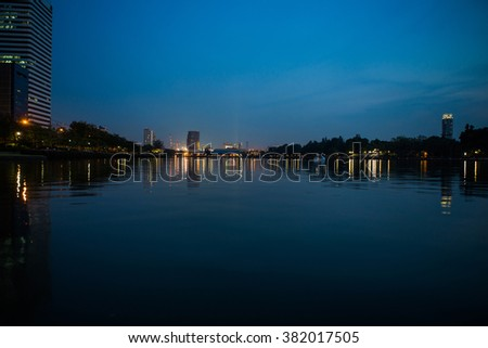 Thailand, Bangkok - April 27, 2015 :: Lake at the night Benchakitti Park in Bangkok. Benjakiti Park is a park in honor of Her Majesty Queen Sirikit, is located in the factory area.night shoot.