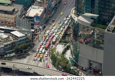 THAILAND, BANGKOK - FEB 19: Road in street clamped modern houses, on February 19, 20125 in Bangkok, Thailand.  Statistically annually 150,000 new cars join the busy roads of the Thai capital - stock photo