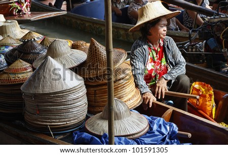 Thailand, Bangkok, Floating Market, Thai hats for sale on a boat - stock photo