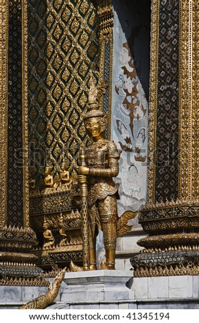 Thailand, Bangkok, Imperial Palace, Imperial city, golden statue at the entrance of a temple