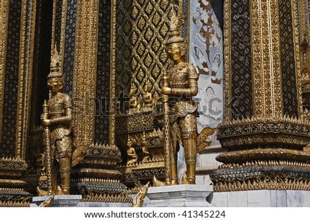 Thailand, Bangkok, Imperial Palace, Imperial city, golden statues at the entrance of a temple