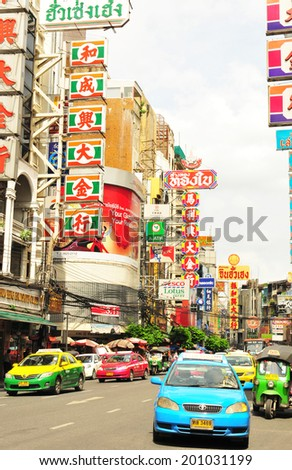 THAILAND,BANGKOK - June 9: Yaowarat Road,the main street in Chinatown, built by King Rama V.This crowded street winds through the bustling heart of Chinatown on June 9, 2014 in China town, Bangkok - stock photo