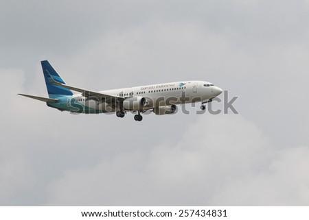 THAILAND,BANGKOK-MAR 3:Garuda Airline plane flying above suvarnabhumi airport runway and prepare to landing  in bangkok on march 3,2015 in  Bangkok Thailand - stock photo