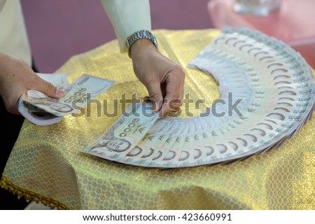 Thailand banknotes arranged to set up engagement decorate for wedding ceremony in thai culture - stock photo