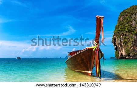 Thailand beach landscape tropical background. Asia ocean nature and wooden boat