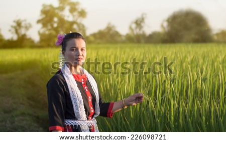Thailand beautiful woman among  green Rice ;Tribal Thai Yoi