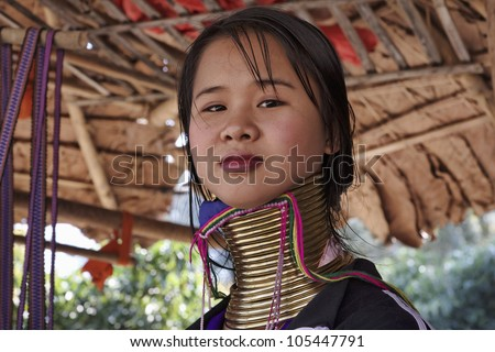 Thailand, Chang Mai, Karen Long Neck hill tribe village (Kayan Lahwi), Long Neck woman in traditional costumes - stock photo