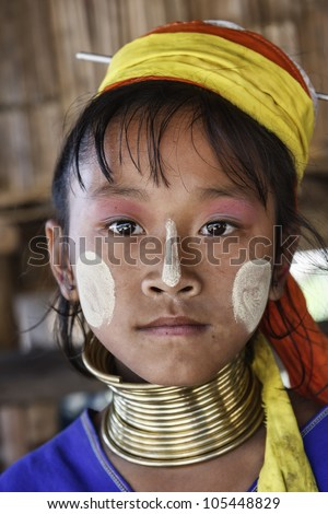 Thailand, Chang Mai, Karen Long Neck hill tribe village (Kayan Lahwi), Long Neck young girl in traditional costumes - stock photo