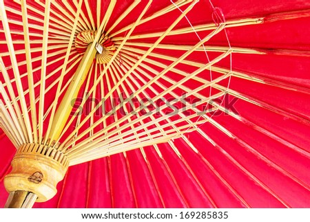 Thailand, Chiang Mai, hand painted red Thai umbrellas . - stock photo