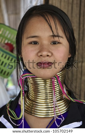 Thailand, Chiang Mai, Karen Long Neck hill tribe village (Kayan Lahwi), Long Neck woman in traditional costumes. Women put brass rings on their neck when they are 5 or 6 years old - stock photo