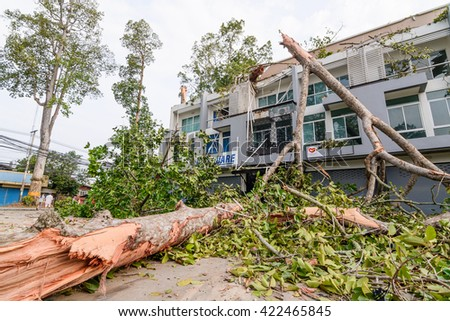 THAILAND, CHIANG MAI - MAY 17: Damage building and cars by falling trees after hard rain storm in Sarapee of Chiang Mai, Thailand on May 17, 2016. - stock photo