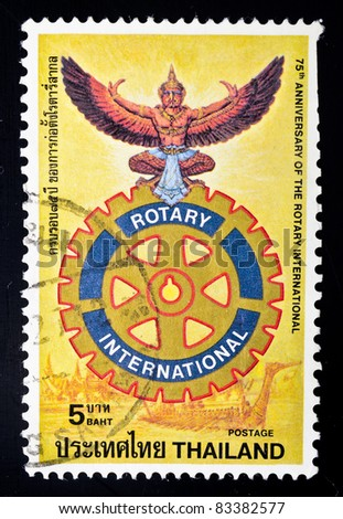 THAILAND - CIRCA 1980: A stamp from Thailand shows image of a garuda (mythical bird) and the Rotary emblem and commemorates the 75th anniversary of Rotary International, circa 1980