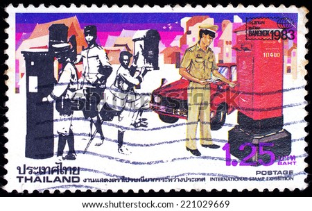THAILAND - CIRCA 1983: A stamp printed in Thailand shows image of postman working, To commemorate International Stamp Exhibition, circa 1983  - stock photo