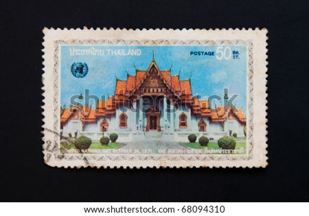THAILAND - CIRCA 1980: A stamp printed in THAILAND shows image of the United Nations Day at a Thai Temple Art and Architecture from Buddhist temples in Thailand circa 1980. - stock photo