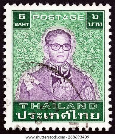 THAILAND - CIRCA 1984: A stamp printed in Thailand shows King Bhumibol Adulyadej, circa 1984.  - stock photo