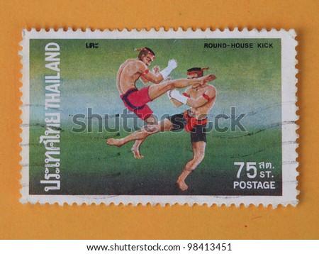 THAILAND - CIRCA 1984: A stamp printed in Thailand shows Thai boxing style, circa 1984 - stock photo