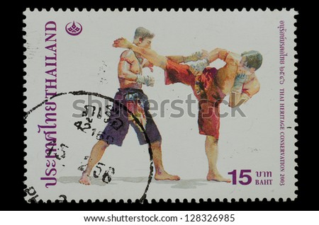 THAILAND - CIRCA 2003: A stamp printed in Thailand ,shows Thai boxing style from the series Thai Heritage Conservation, circa 2003 - stock photo