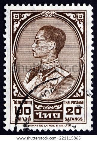 THAILAND - CIRCA 1962: a stamp printed in the Thailand shows King Bhumibol Adulyadej, Rama IX, King of Thailand, circa 1962 - stock photo