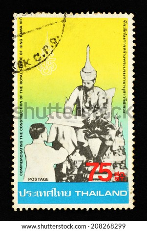 THAILAND - CIRCA 1980: Yellow color postage stamp printed in Thailand with image of the Thai King and his subject to commemorate the construction of the Royal statue of King Rama VII.
