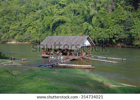 Thailand - DECEMBER 29, 2013: Boats and rafts with tourists on the river Kwai