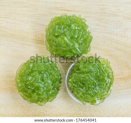 Thailand dessert, sticky rice, pandan flavored glass. - stock photo