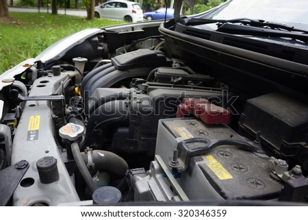 Thailand Eco Car 1600cc  with open hood show parts in side. - stock photo
