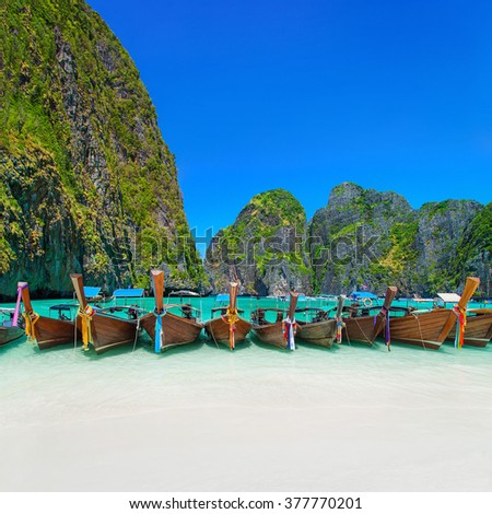 Thailand exotic beach view at ring of steep limestone hills with many traditional longtail boats parking, Maya Bay, Ko Phi Phi Lee island, Phi Phi archipelago, part of Krabi Province, Andaman Sea - stock photo