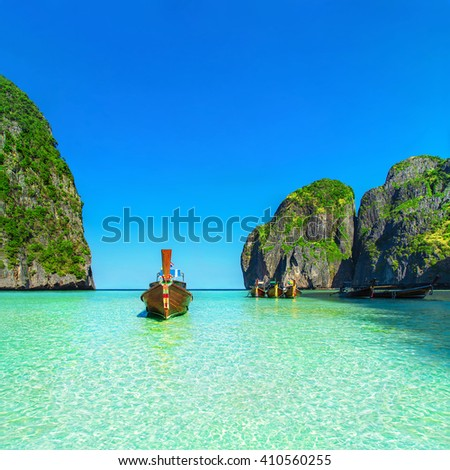 Thailand exotic beach view with traditional longtail boats against steep limestone hills after flood tide, Maya Bay, Ko Phi Phi Lee island, Phi Phi archipelago, part of Krabi Province, Andaman Sea - stock photo