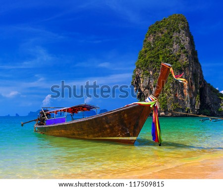 Thailand exotic tropical beach. Blue sky, sand and traditional boat - stock photo