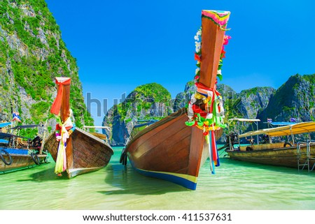 Thailand famous beach seascape with traditional bright adorned longtail boats, Maya Bay, Ko Phi Phi Lee island, Phi Phi archipelago, part of Krabi Province, Andaman Sea - stock photo