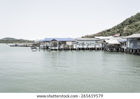 Thailand Fishing Village with a boat in the harbour.
