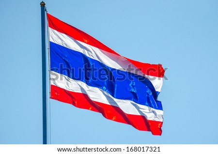 Thailand flag on the top of the pole in a windy day