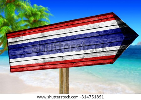 Thailand Flag wooden sign on beach background - stock photo