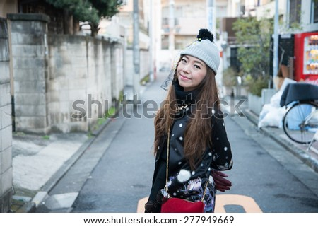 Thailand Girl in the streets of tokyo,Japan - stock photo